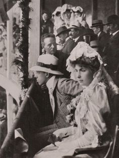 1906 : Princess Victoria Eugenie of Battenberg and her fiancé Alfonso XIII watching a bull fight