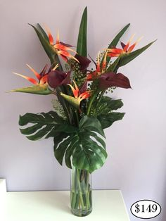 Calla Lily & Birds of Paradise REAL TOUCH Flower Arrangements LOOK and FEEL REAL and are permanently set hard in a clear ARTIFICIAL WATER, guaranteed to look fresh forever. Handmade, modern Flower Arrangements that are ideal for Allergy Sufferers. Perfect for Home Decor, Weddings, Offices and Special Occasions. Flower Arrangements come exactly as pictured, with flowers, vase and simulated water. Easy to clean with baby wipes. Pick-up welcome or cheap courier delivery available Australia…