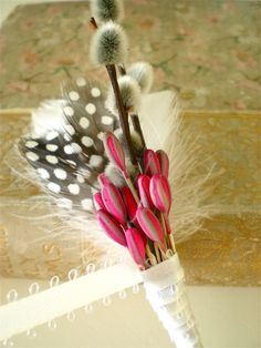 Pwillow boutonniere with magenta accents.