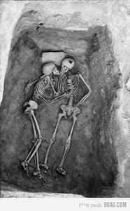 'The Lovers' from 1972 season at Hasanlu. Hasanlu is an archaeological excavation site in Iran, Western Azerbaijan, Solduz Valley. Theses skeletons were found in a Bin with no objects. The only feature is a stone slab under the head of the skeleton on the lefthand side.
