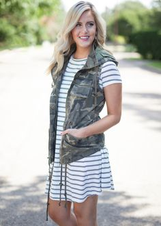 Adorable camo print vest with hood! Hood can be taken off and on with zipper. Paired with our In Your Element Striped Dress. Shell: 100% Cotton Lining: 100% Po