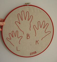 plumpudding: Embroidered hand prints  --gift idea? maybe with painted hand prints instead of embroidered, as I have no time for that