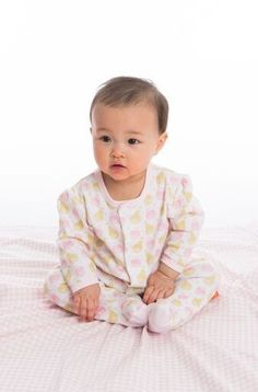 A soft, pink and golden yellow pear print graces this adorable footie.