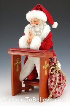 Giving Thanks- Santa kneeling and saying his prayers.