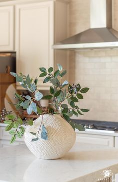 Spring Decorating Ideas with Fake Flowers in a white large vase in our kitchen.
