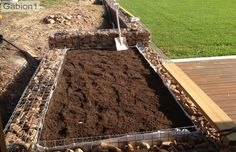 gabion planter lined with filter fabric to contain the soil http://www.gabion1.com