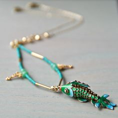 http://www.notonthehighstreet.com/katieweinerjewellery/product/turquoise-and-gold-charm-necklace-with-fish http://www.katieweiner.com/product/turquoise-and-gold-charm-necklace-with-fish/
