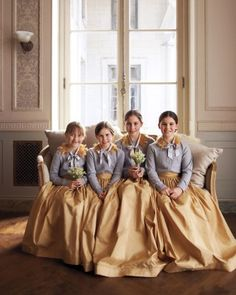 Four young attendants wore taffeta skirts and cashmere cardigans accented with fur collars.