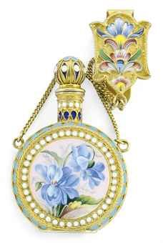 """A RUSSIAN SILVER-GILT AND CLOISONNE ENAMEL SCENT BOTTLE DEPENDENT FROM A CONFORMING ENAMELED CLIP, MARIASEMENOVA, MOSCOW, CIRCA 1896-1908. THE CLIP, CAP AND SIDES WITH SHADED ENAMEL FLORAL DECORTION, THE FRONT AND BACK WITH WHITE BEADED BORDERS ENCIRCLING """"EN PLEIN"""" PANELS OF BLUE PANSIES ON PALE PINK GROUND."""