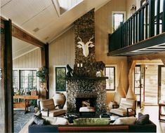 A stone fireplace and paneled walls preserve the traditional all-American nature of this home.