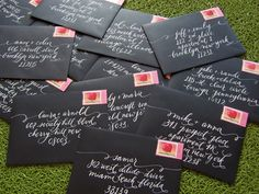 White Calligraphy on Black envelopes. I love the red in the postage stamps, it adds a needed pop of color.
