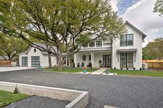 White houses with black windows exterior farmhouse with covered porch two car garage