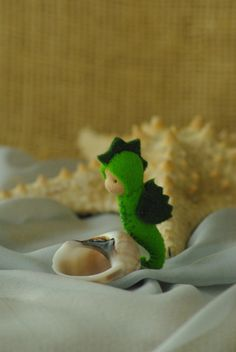 Seahorse Toy - Gift from the Tooth Fairy // Waldorf natural toy // Fish Toy // Waldorf Sea by TaleWorld on Etsy https://www.etsy.com/listing/231790729/seahorse-toy-gift-from-the-tooth-fairy