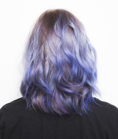 If you want to achieve this purple hair color, you need to know the right things to tell your stylist. The ombre color was achieved by mixing blue highlights with purple hair color from Manic Panic.  See how our model went from blonde to periwinkle when you click through.