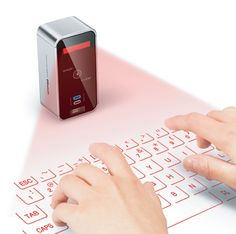 A virtual, projected keyboard/multi-touch trackpad.  Pretty cool.  Though I think just the trackpad alone would be enough for me (also available as evoMouse)