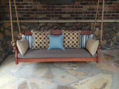 """""""Cushions from Cushion Source for a 5' porch swing on a newly renovated rustic front porch."""" Featured Fabric: Sunbrella Dupione Stone, Sunbrella Dupione Celeste, Sunbrella Heritage Wheat, Sunbrella Carnegie Celeste, and Sunbrella Tango Mink"""