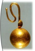 """Anatolia-Zonguldak Devrek    The 2nd century AD  One end of the """"S"""" shaped ring has been inserted in the fixed earring particle in the form of a ball. The other end ends profiled. At the location where the ring goes into the ball, there is a small disk mounted to the ring. It is formed and coated by hammering the sheet on internal mould."""