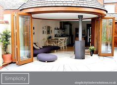Handcrafted from Western Red Cedar, this 8-door curved folding-sliding door system enabled a dramatic architectural effect that allows panoramic views to the garden