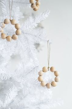 boho christmas tree Treat your tree to some simple Nordic decor this year with these easy to make beaded mini wreaths that scream Scandinavian style! Rustic Christmas Ornaments, Scandinavian Christmas Decorations, Christmas Wreaths To Make, Simple Christmas, Christmas Home, Handmade Christmas, Christmas Holidays, Christmas Tables, Diy Ornaments