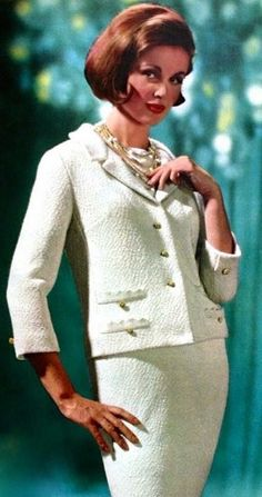 A Chanel inspired blazer costume, Montgomery Ward Christmas Catalog 1964 vintage fashion designer looks style mid 60s classic boxy suit jacket skirt winter white dress gold tone buttons model magazine