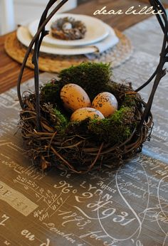 Nest basket with speckled eggs as table centerpiece ~~ for the kitchen table