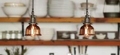 A pair of Georges, Industrial-style pendants, work well as kitchen task lights.