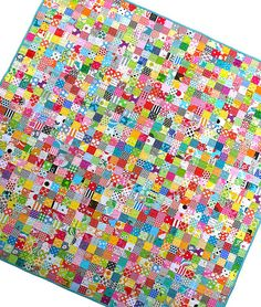Postage Stamp Quilt  --  tutorial  link at the end of the pictures.  Great way to use of all your scraps.