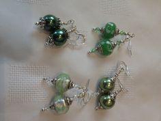 green pandora style earrings