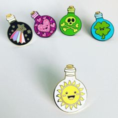Bring some sunshine into your life with this Happiness potion bottle hard enamel pin badge. Great to send to someone as a get well wish, or to someone who just needs a little smile.  This 30mm hard enamel pin badge attaches to t-shirts, jackets and bags easily with the yellow rubber