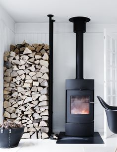 """42 Lovely Scandinavian Fireplace To Rock This Year. A stone fireplace design your pioneer ancestors would envy is the """"Multifunctional Fireplace. Farmhouse Homes, Farmhouse Design, Farmhouse Interior, Scandinavian Fireplace, Scandinavian Cabin, Stone Fireplace Designs, Home Fireplace, Fireplace Ideas, Black Fireplace"""