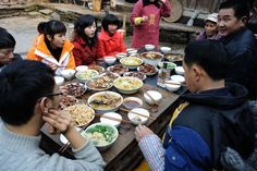 Spring Festival 2011 in rural China - Getty Images  A reunion dinner  Families often get together for meals, especially for a feast on New Year's Eve. Since eight is a lucky number, the meal often consists of eight courses. Apart from servings of dumplings and rice cakes, traditional foods include fish, tangerines and uncut noodles that signify long life.