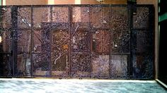 A very cool gate made of welded bolts, washers, nails, wrenches, etc. in downtown Greenville