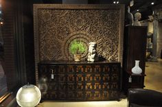 Chinese Medicine Cabinet, Thai ceiling panel carving, large glass chandelier from France on the floor.