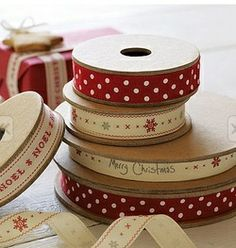 Holiday Wrapping Ideas - Keep it simple - Pretty ribbons on butcher-block paper (in brown or white), or newspaper