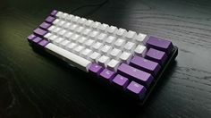 Ducky purple backlit and probably Vortex/KBT PBT+POM on Poker II. Low profile case.