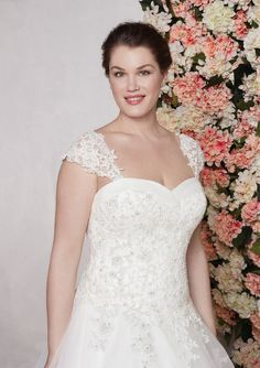 24978 - Becky - This lightly beaded lace and tulle ball gown with a sweetheart neckline was inspired by your fairy tale romance. It features detachable straps and a full tulle ball gown skirt with a chapel length train. Try this beauty on at Aurora Bridal in Melbourne, FL (321)254-3880