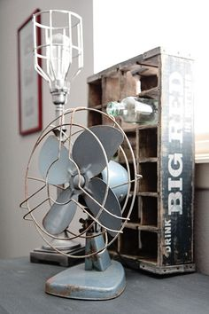 Industrial  Lamp, Vintage Fan and a Soda Crate