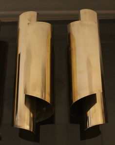 1970's Elegant Brass Wall Lamps | From a unique collection of antique and modern wall lights and sconces at https://www.1stdibs.com/furniture/lighting/sconces-wall-lights/