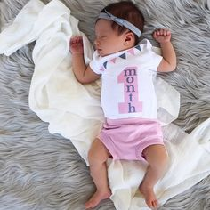 Our pink & grey 1 month old baby girl milestone outfit is the perfect outfit for your baby girl to celebrate her 1st month of life in. This bodysuit is part of a line we've designed and every month is available for both baby girls and baby boys, making it the perfect baby shower gift set!