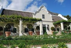 Houses For Sale in Franschhoek. View our selection of apartments, flats, farms, luxury properties and houses for sale in Franschhoek by our knowledgeable Estate Agents. Dutch Gardens, Cape Dutch, African House, Dutch House, Spanish Architecture, My Ideal Home, Dutch Colonial, Courtyard House, Spanish House