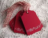 red tags baking twine candy canes snowflakes in white