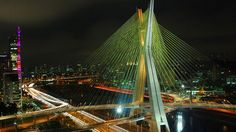 """Octavio Frias de Oliveira Bridge Cable-stayed bridge in São Paulo, Brazil. This bridge is unusual due to its form, which is similar to an """"X"""". It is the only bridge in the world that has two curved tracks supported by a single concrete mast. San Paulo, Places Around The World, Around The Worlds, Cable Stayed Bridge, Famous Bridges, Bridge Design, South America Travel, Travel Videos, Amazing Architecture"""