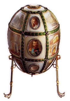 The Fifteenth Anniversary Egg. The opalescent and opaque white enamel egg is encased within a grid-shaped cage work of gold and green enamel garlands which frame eighteen scenes painted by court miniaturist Vassily Zuiev. Some of the events of Tsar Nicholas II and Tsarina Alexandra's reign over the past fifteen years are recorded in these historical vignettes. Individual portraits of the czarina, her husband and their five children each set within oval-shaped apertures bordered by diamonds…