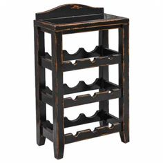 Uttermost Halton Weathered Black Layered Natural Wooden Wine Rack Table  Distressed Black Floor Wine Rack Table with Black Glass Surface Hand Carved Solid Mango Wood With Rubbed Black Finish Distressed To Show Natural Wood Undertones. Top Is Black Glass.