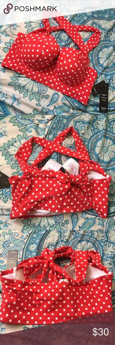 Halter Vintage Swim Top Brand new halter too for swimming! It gives you the classic retro look and it absolutely looks stunning! I never got a chance to use it so it needs a new home! This comes in a size 0 from Torrid but I'd say it fit a size 36D or 40C. The strips are nice and thick perfect to keep the girls in place and back support. torrid Swim Bikinis