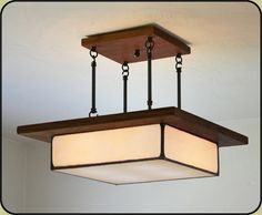 "Arts and Crafts Style Light Fixture | Mission Studio.  Also comes w/design as flush mount. various sizes (17"", 21"", 29""): starts at $610  pick glass and wood colors"