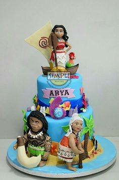 Moana, the island princess, with Maui, Gramma Tala and HeiHei Moana cake with edible fondant figures as cake toppers