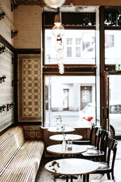 Love the interior of the Fleischerei Bar/Cafe in Leipzig, Germany. Photographed by Daniel Faro , this century-old restored form.