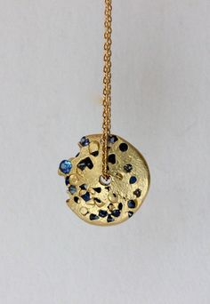 Blue sapphire, eroded disc pendant necklace by Polly Wales