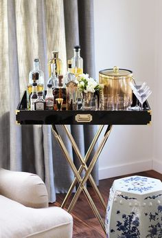 New Year's Eve DIY Party Decor | POPSUGAR Home  DIY black and gold bar cart tray